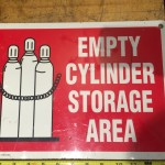 empty cylinder storage area sign metal safety supply vintage