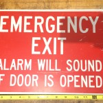 emergency exit alarm will sounf if opened metal sign